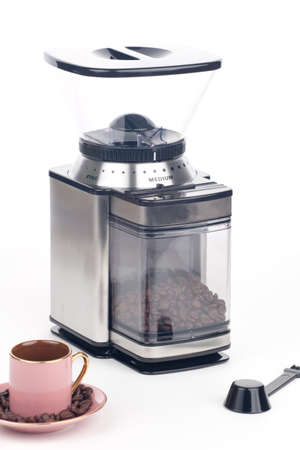 Closeup of modern coffee grinder with coffee beans around over white Stock Photo - 15401041
