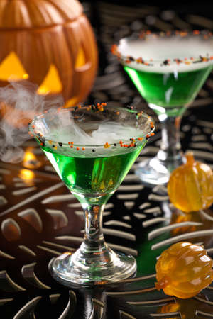 Closeup of Witch Blood Martini, vodka, gin, vermouth, and liquor - Halloween drinks series Stock Photo - 15533119
