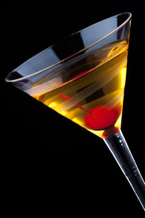 shaken: French martini in chilled glass over black background on reflection surface, garnished with maraschino cherry  Most popular cocktails series