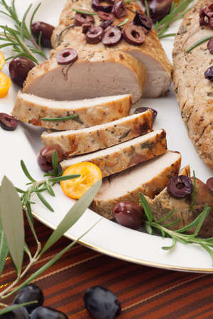 vermouth: Closeup of delicious sliced roast pork tenderloin with olives, vermouth, and citrus  Stock Photo