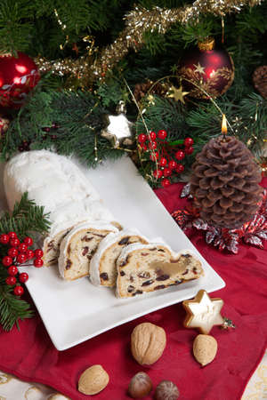 traditional german christmas cake cranberry stollen christmas tree ornaments and candles photo - German Christmas Tree