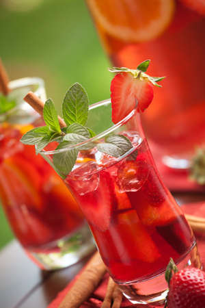 Closeup of two glass of spicy strawberry Sangria on outside table  photo