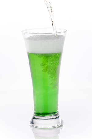 Glass of green beer for St Patrick photo