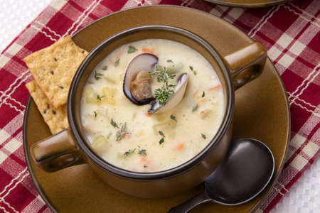 Bowls of hot delicious clam chowder garnished with fresh thyme, and multy grain crackers Stock Photo - 17902449