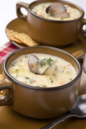 Bowls of hot delicious clam chowder garnished with fresh thyme, and multy grain crackers Stock Photo - 17902447