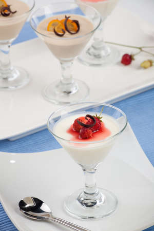Closeup of Strawberry Panna Cotta Dessert garnished with Alpine strawberries, and chocolate shavings  photo