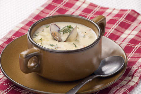 Bowls of hot delicious clam chowder garnished with fresh thyme, and multy grain crackers Stock Photo - 18236234
