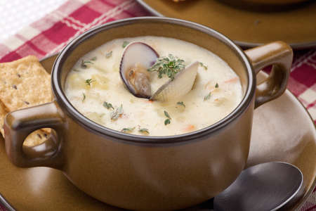 Bowls of hot delicious clam chowder garnished with fresh thyme, and multy grain crackers Stock Photo - 18378291