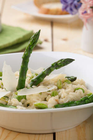 Vegetarian Risotto with asparagus, edamame, and Parmesan cheese.  photo