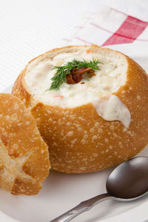 Sourdough bun of delicious hot clam chowder garnished with bacon, and dill Stock Photo - 18968786