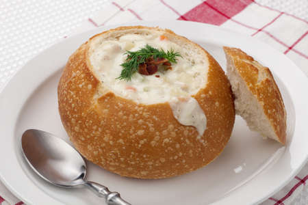 Sourdough bun of delicious hot clam chowder garnished with bacon, and dill  Stock Photo - 19090810