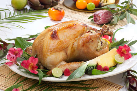 Garnished roasted turkey with tropical fruits, flowers, and refreshing cocktails Stock Photo - 19263318