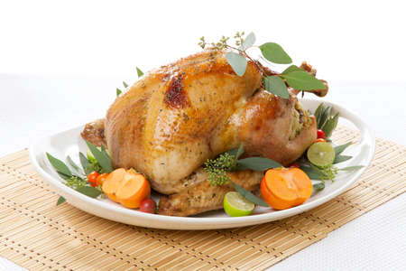 Garnished roasted turkey with tropical fruits over white background Stock Photo - 19409695