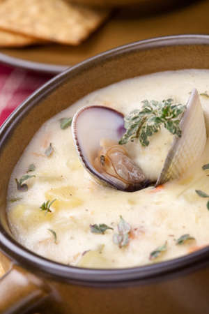 Bowls of hot delicious clam chowder garnished with fresh thyme, and multy grain crackers Stock Photo - 19409711