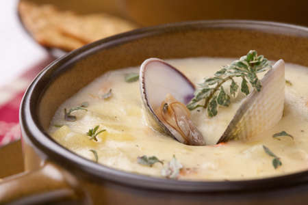 chowder: Bowls of hot delicious clam chowder garnished with fresh thyme, and multy grain crackers Stock Photo
