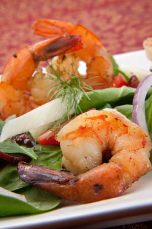 Shrimp and spinach salad with grape tomatoes and balsamic mustard vinaigrette