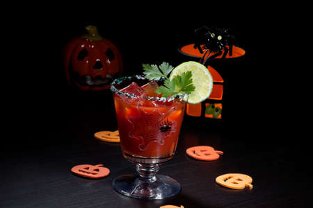 Closeup of Bloody Mary cocktail, garnished with lemon and parsley - Halloween drinks series