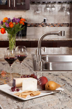 Modern house new contemporary luxury custom kitchen and refreshments on exotic granite countertop Stock Photo - 23043731
