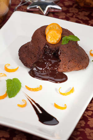 cumquat: Delicious dark chocolate lava cake dessert served with fresh cumquat and mint  Surrounded by Christmas ornaments