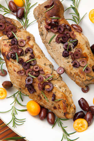 vermouth: Delicious roast pork tenderloin with olives, vermouth, and citrus  Stock Photo