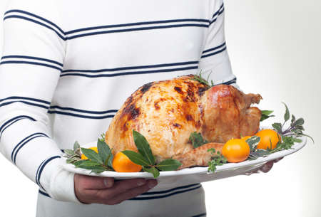stuffing: Garnished citrus glazed roasted turkey on platter is ready to be served Stock Photo