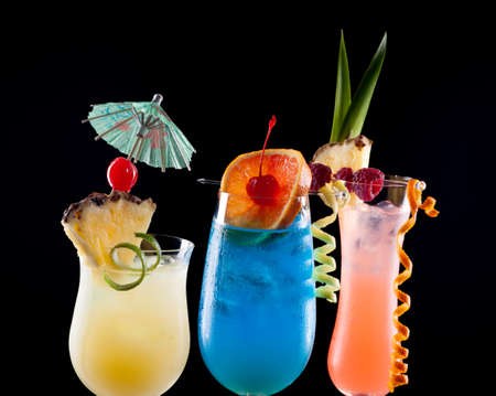 bahama: Rum Runner, Bahama Mama, and Blue Lagoon cocktails over black background Stock Photo