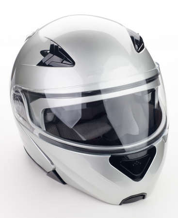 High quality light gray motorcycle helmet over white background, studio isolated