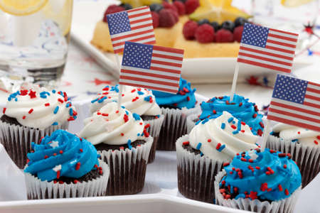 Chocolate muffins with white and blue icing on 4th of July in patriotic theme  photo