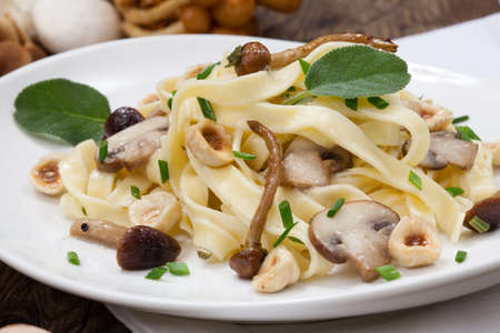 Wild mushrooms Linguini pasta with roasted hazelnut, sage, and chives