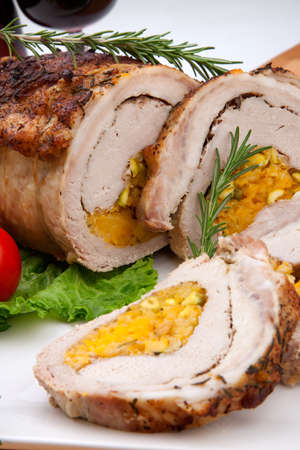 roulade: Dried apricots, pistachios, and rosemary staffed pork loin roulade served with salad, tomatoes and glass of red wine.