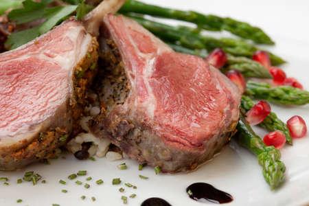 lamb chop: Herb crusted lamb chops (ribs) garnished with asparagus, carrots, and pomegranates. Mini pumpkins and fresh fruits