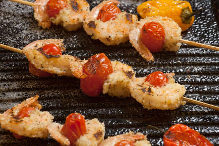 griddle: Grilled Parmesan crust shrimp with chery tomatoes on the grill with grilled mini bell peppers.