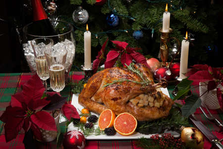 stuffing: Roasted turkey with fresh fruits, flutes of champagne, Christmas tree, candles, and decorations