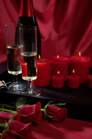 candle light dinner: Celebration tray for Valentines Day - Champagne, chocolate raspberry cake, candles, and red roses.