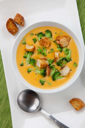 meals: Close up of hot delicious broccoli - cheddar cheese soup with garlic croutons. Stock Photo