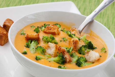 soup bowl: Close up of hot delicious broccoli - cheddar cheese soup with garlic croutons. Stock Photo