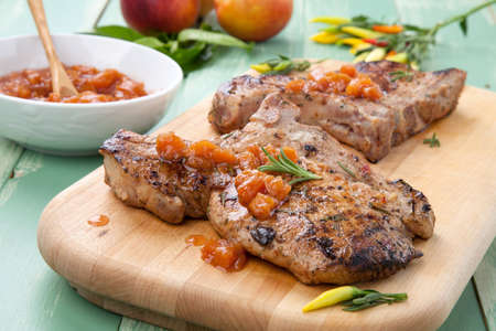 chops: Grilled pork chops with nectarine - pepper chutney. Fresh nectarines and hot pepper.