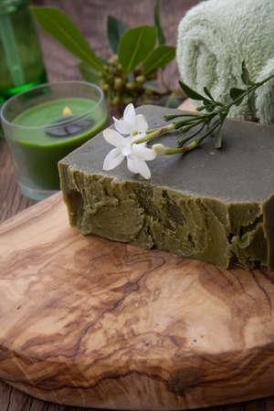 Spa set - assorted handmade organic soap, fresh Jasmine flowers, and bottle of organic oil for spa treatment. Stock Photo