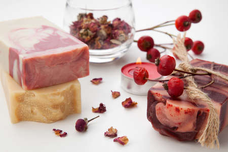Spa set - handmade rose organic soap, dried rose flowers, and rosehips. Best suited for relaxing and health commercials. Archivio Fotografico