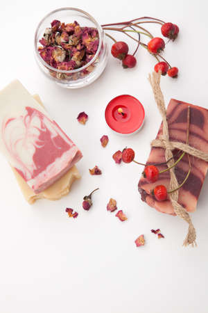 Spa set - handmade rose organic soap, dried rose flowers, and rosehips. Best suited for relaxing and health commercials. Stock Photo