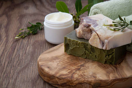 Spa set - assorted handmade organic soap, fresh Jasmine flowers, and jar of moisturizing face cream for spa treatment.