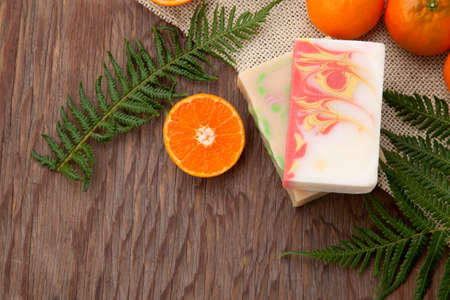 Spa set - handmade citrus oil organic soap, fresh oranges, and fern. Best suited for relaxing and health commercials.
