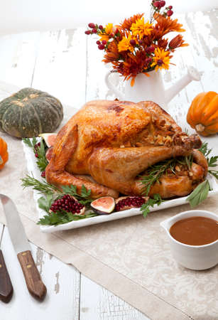 Garnished traditional roasted turkey for Thanksgiving Stok Fotoğraf - 133925940