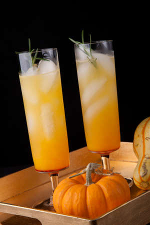 Closeup of Pear Sparkler cocktail and mini pumpkins on a tray. Fall Drinks series.
