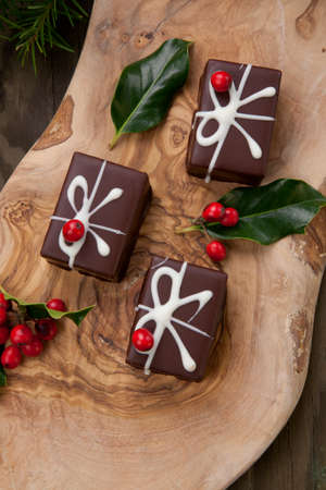 Traditional Christmas chocolate candy, Christmas ornaments, decorations, and red berries.