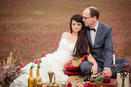 husband wife: two lovers wedding couple husband wife love nature honeymoon love-story bouquet of flowers