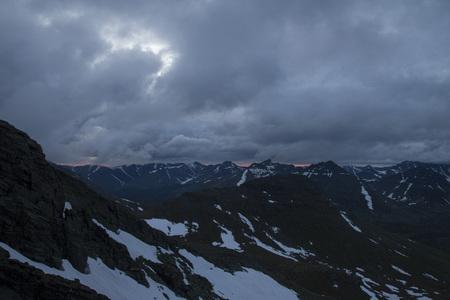aletsch: mountainous terrain with snow tops of mountains cloudy