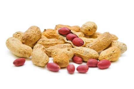 roasted peanuts closeup on white background Stock Photo