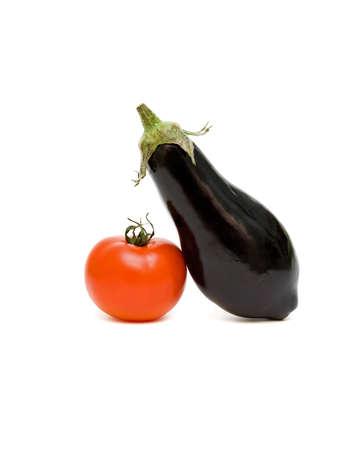 Eggplant and tomato on white background close up