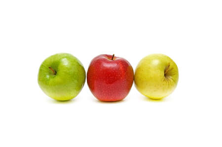 apples of different colors closeup on white background